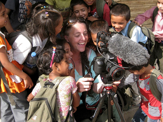 Gail Mooney showing kids her video shot at Kopila Valley Childre
